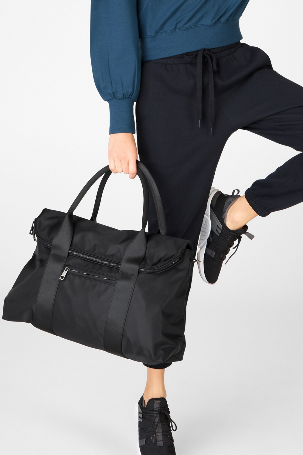 You asked, we listened. Our customer-favorite tote is back and better than ever with a front pocket to stash your stuff on the go. And that means life just got a little bit easier.