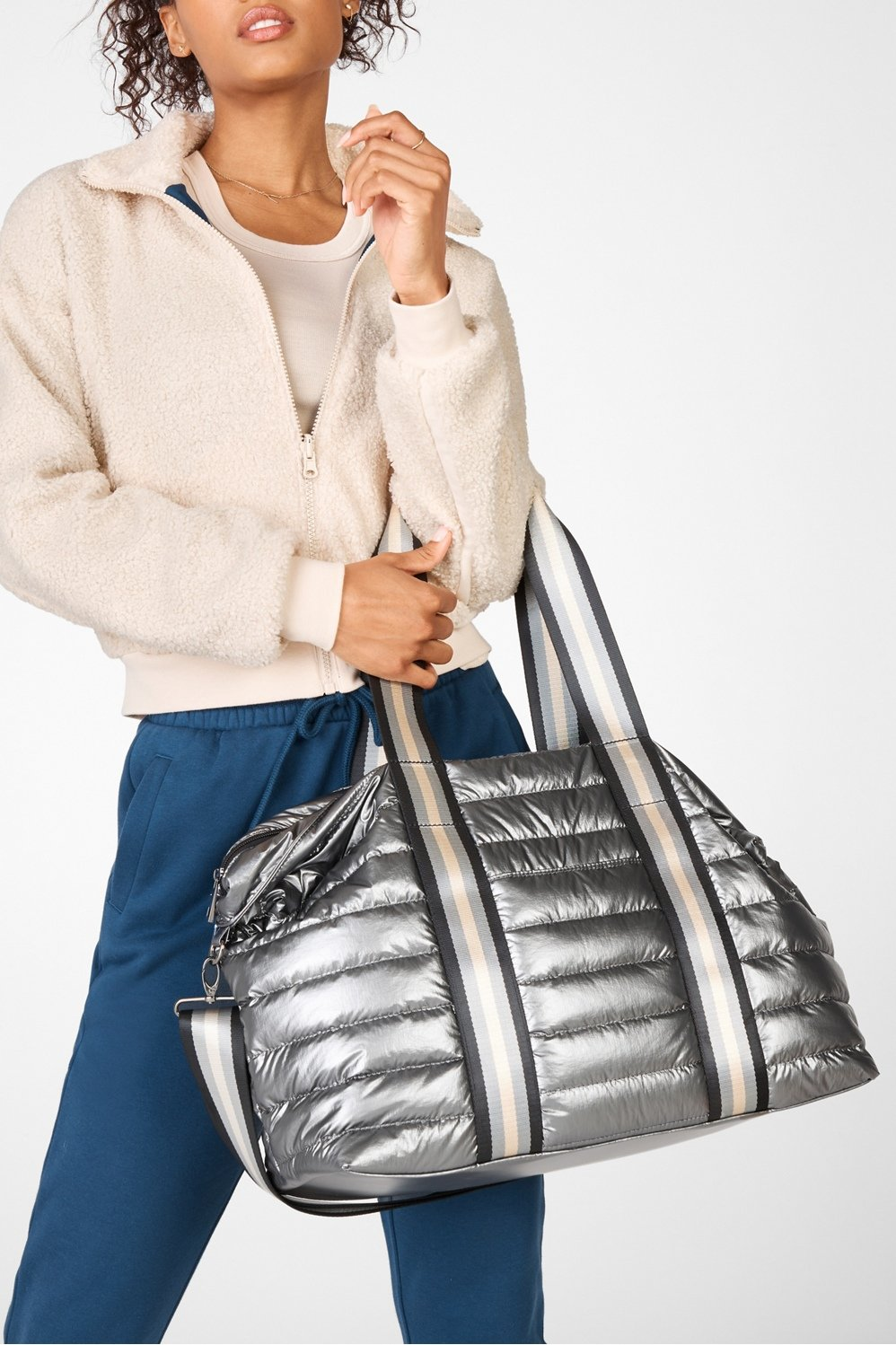 Upgrade that tote you use for every activity. With quilted texture for an extra level of sophistication and enough space to keep every detail of your life organized, ours fits in wherever you go.
