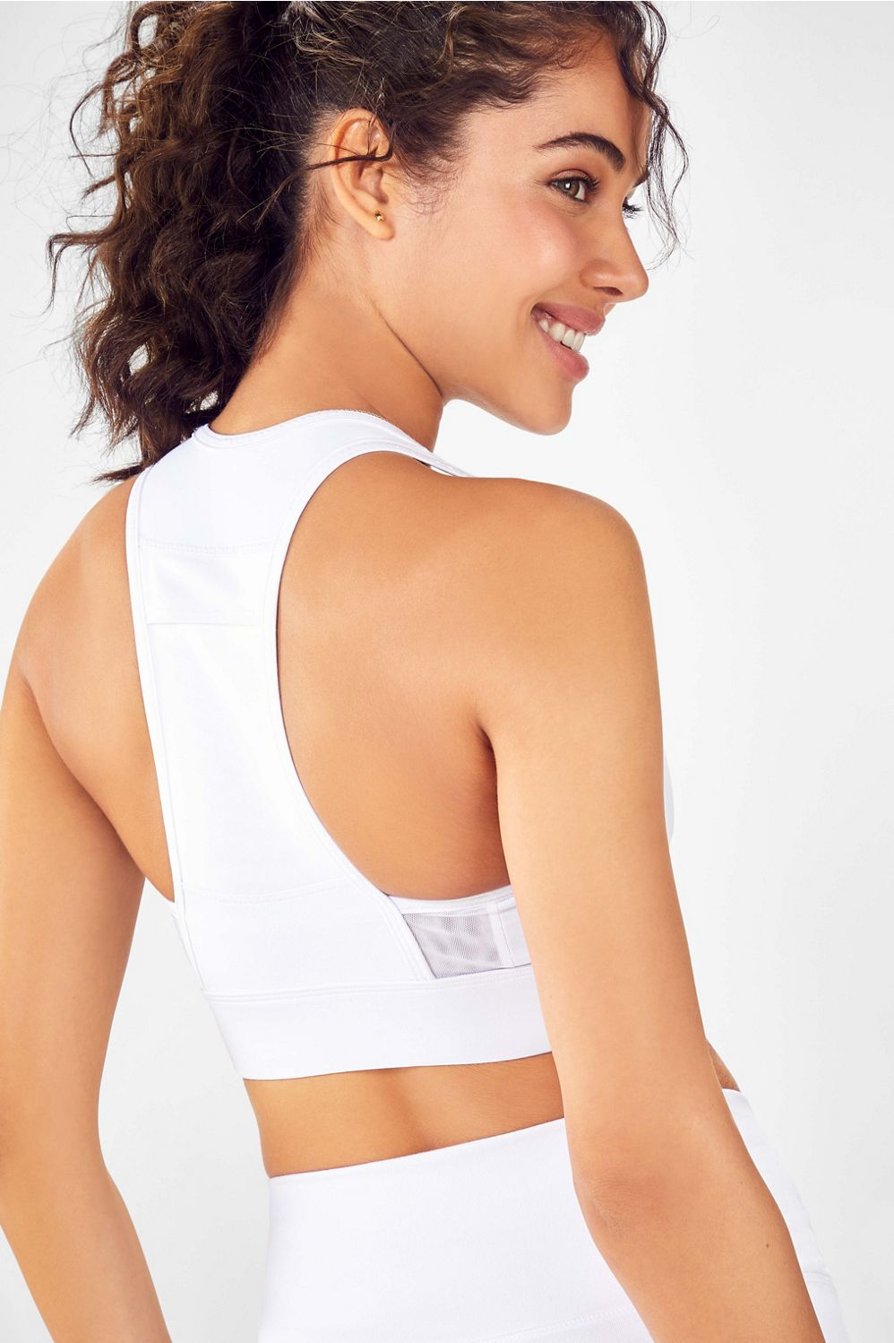 Pockets make everything better. That\\\'s why we added a back pocket to your medium-support bra, so you can stash away your cash or keys while you\\\'re working out.