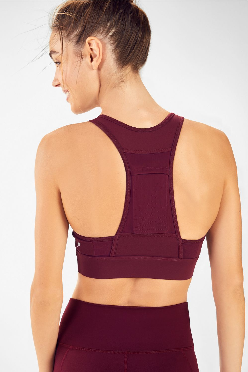 Your favorite bottoms now have a better half. Meet the Mila medium-impact sports bra, built with an external pocket to stash your card or keys.