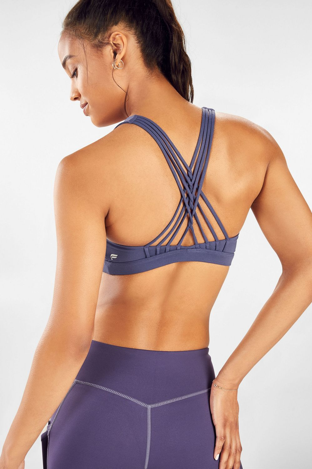 This medium-impact bra from our exclusive Dance Capsule features removable cups and all-way stretch fabric so you can move freely on the stage or in the studio.