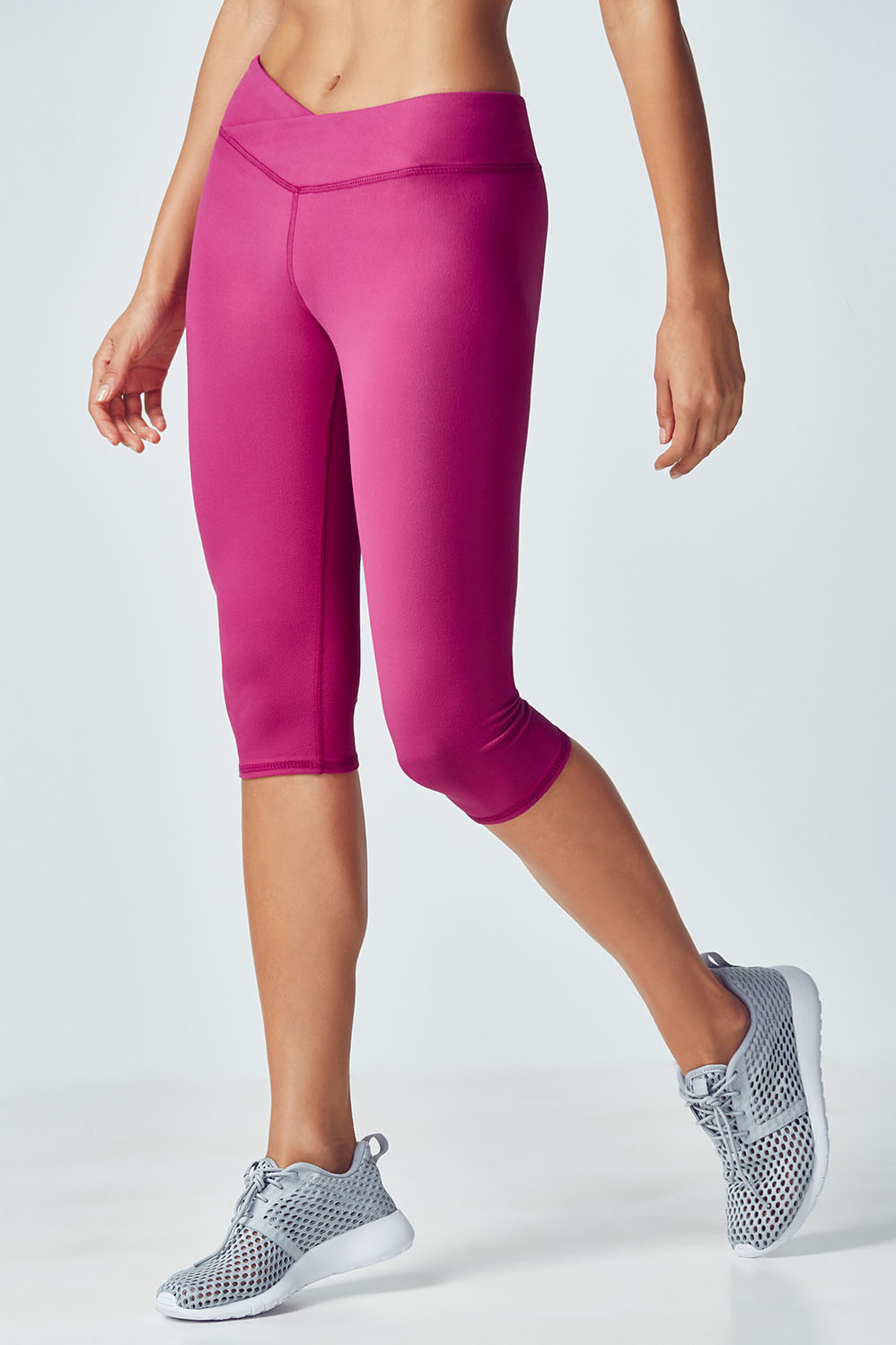 Fabletics Fashion Winn Solid Powerhold Crop Womens Purple Size XS Showcase the best of your body in a mid-rise crossover crop that regulates body heat and blocks harmful rays with UPF technology. UPF 50+, Mid-Rise Crossover Waistband, All-way Stretch, Chafe-resistant, Internal Waistband pocket for cards or keys, Moisture-wicking, Compression Fabric, Fit. Fitted. Hits Below Knee. Inseam. 15 1/2 , Rise. Mid, Fabric Content. 88% Polyester/12% Elastane