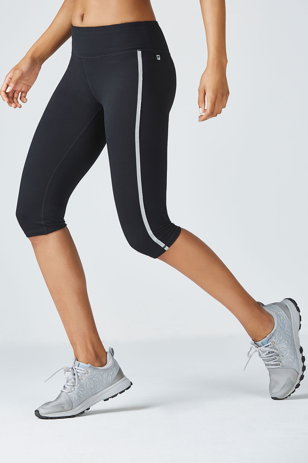 Fabletics Fashion Mckenzie Crop Womens Black Size XS Stripe right in our moisture-wicking, compression crop with bonded silver tape down the leg. A convenient back zipper will store your card during your cardio session, and chafe-free stitching will keep you feeling good from start to finish. UPF 50+, Bonded Zipper Pocket in Back for Key/Card, All-Way Stretch, Chafe-Resistant, Silver Bonded Tape on Leg, Moisture-Wicking, Compression Fabric, Fit. Fitted. Hits Below The Knee, Inseam. 15 1/2 , Fabric Content. 88% Polyester/12% Elastane