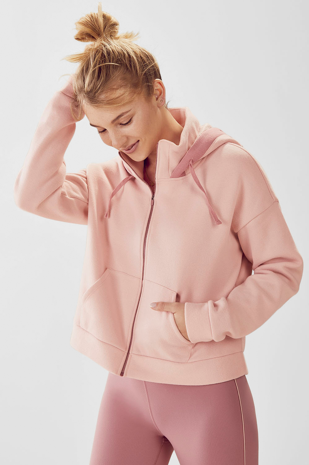 Fabletics Hoodies Valeria Cropped Hoodie Womens Pink Size 1X Look cool and stay warm at the same time by layering on our cropped hoodie with a sporty kangaroo pocket and slouchy dropped shoulders. Kangaroo Pocket, Cropped Silhouette, Hood with Adjustable Drawcord, Dropped Shoulders, Cozy Brushed Fleece, Fit. Relaxed Fit, Removable Cups. N, Built-In Bra. N, Length. Hip, Fabric Content. 65% COTTON/35% POLYESTER