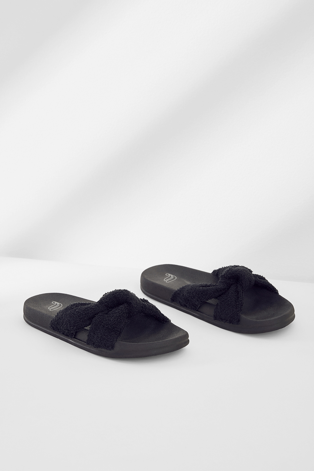Fabletics Fashion Playa Knot Slide Womens Black Size 8 Slide on into the studio in our slip-on-and-go sandals with a plush terry strap and contoured footbed that cradles your feet. Comfortable, Contoured Footbed, Plush Terry Strap, Fabric Content. Textile Upper / Man Made Sole, Fit. True to size