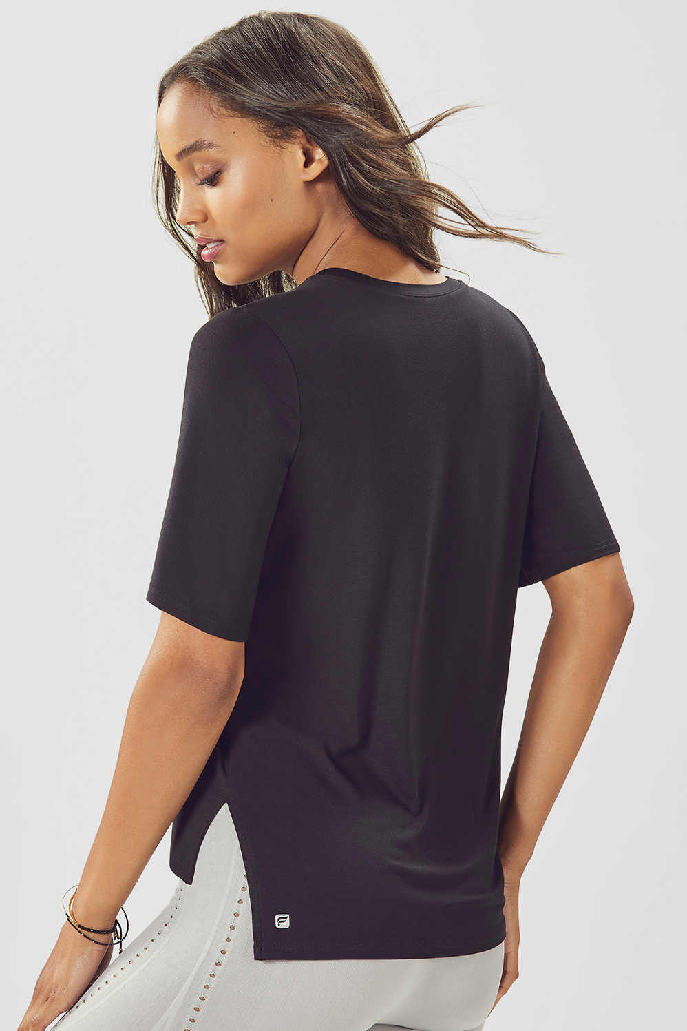 Fabletics T Shirt Bronte S/S Womens Black Size S Retire your basic tee and make room for a new model, designed with flirty flutter sleeves, side slits and a flattering step hem. Soft, Draped Jersey, Flutter Sleeves, Side Slit With Step Hem, Built-In Bra. N, Length. Below Hip, Fabric Content. 95% Rayon/5% Elastane, Fit. Relaxed